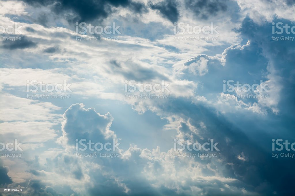 White curly clouds in a blue sky. Sky background stock photo