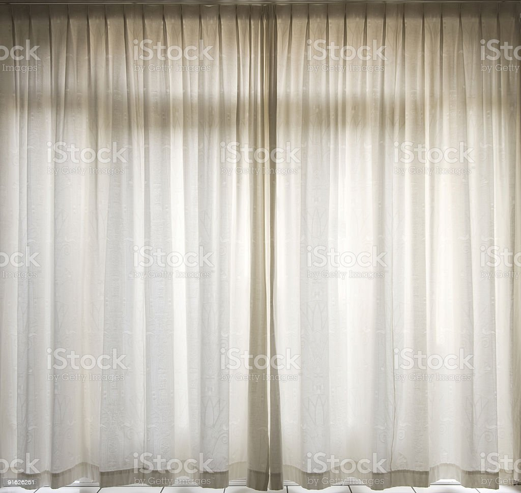 White curtains closed at window royalty-free stock photo