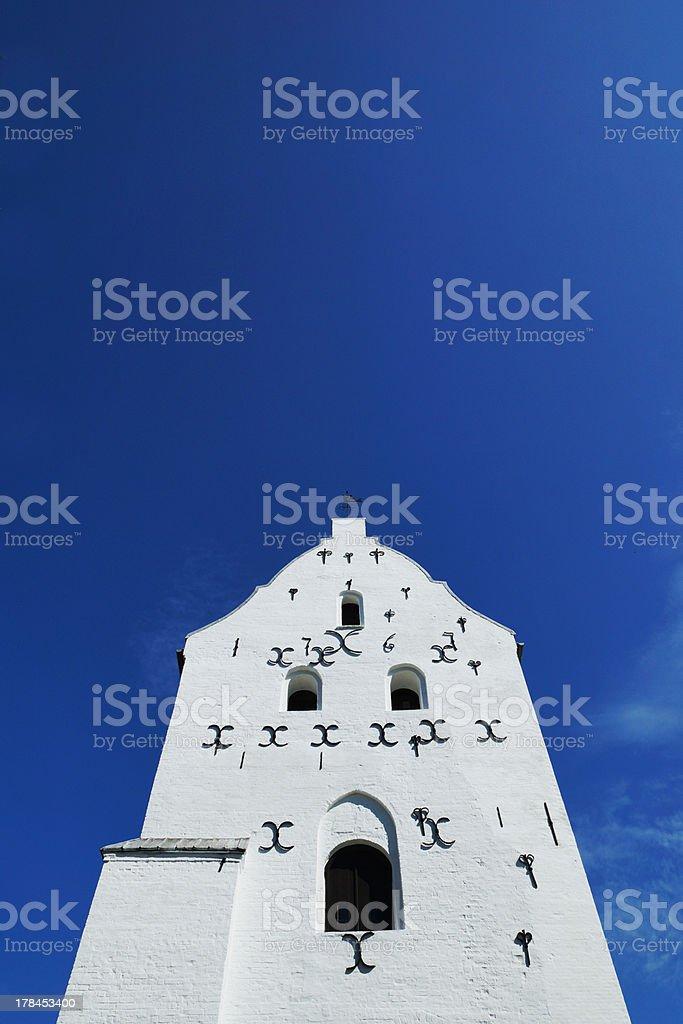 White danish church in bright sunlight stock photo