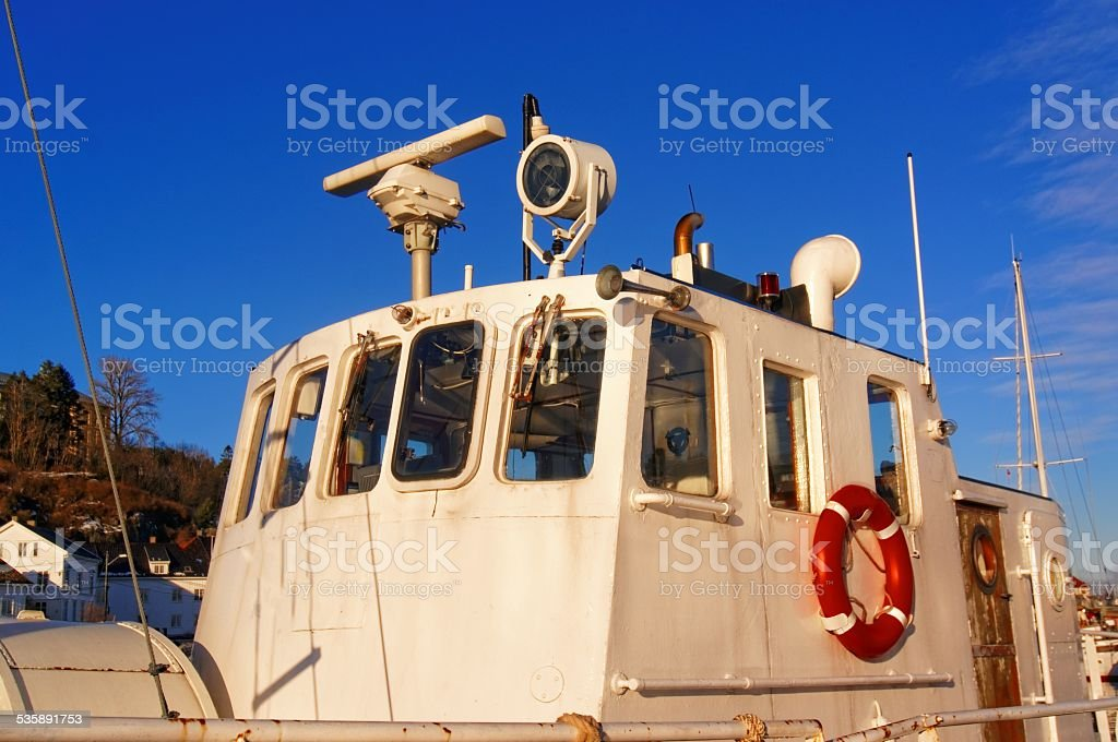White deckhouse on the fishing boat stock photo