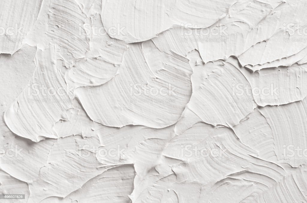 White decorative abstract plaster texture with textured smears. stock photo