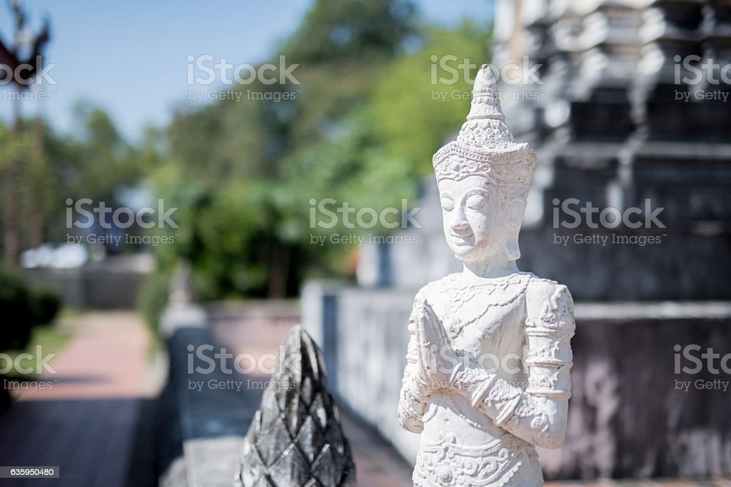 White Deity or Seraph Buddha Statue, Symbol of Peaceful. stock photo