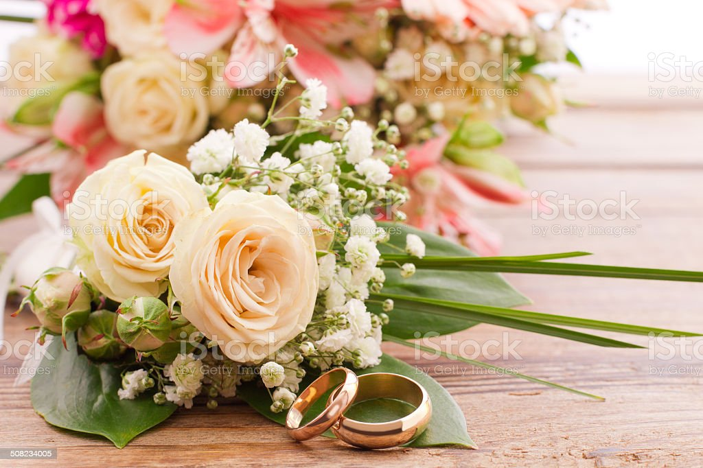 White delicate flowers on wooden surface. Wedding bouquet, background. stock photo