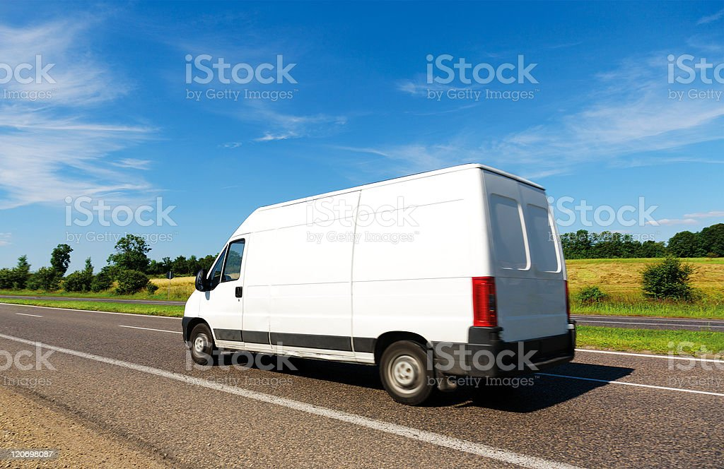 White Delivery Van  on the Road stock photo