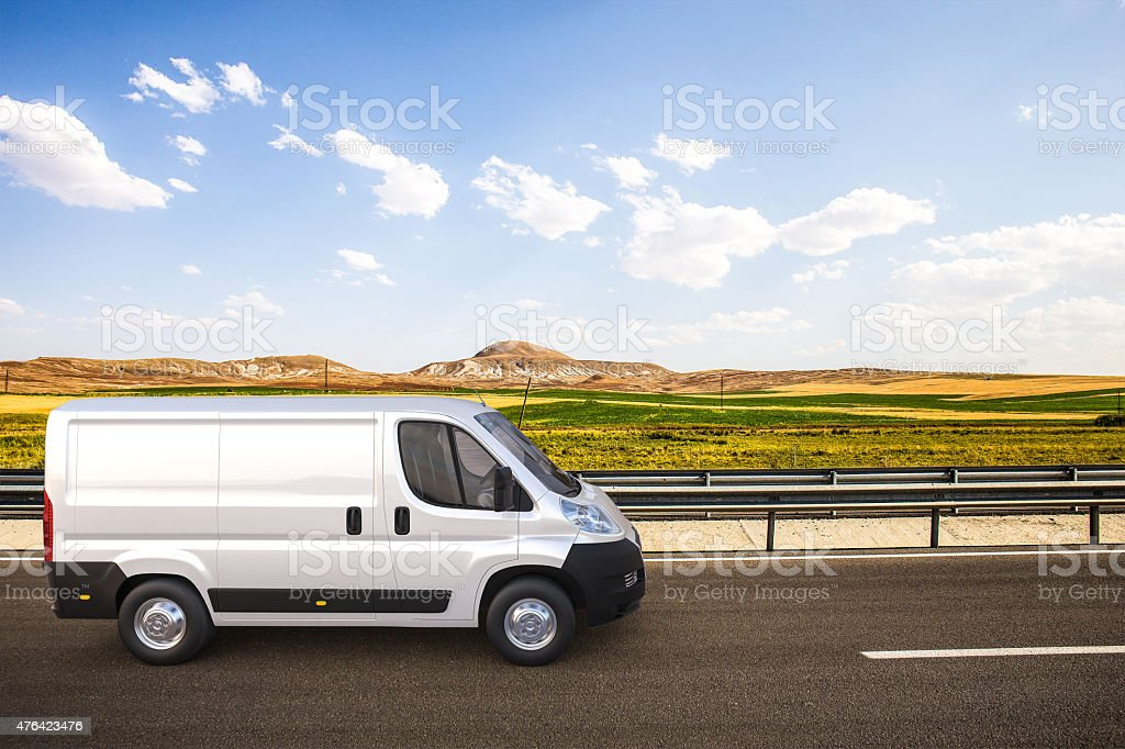 White delivery van on the road with colorful background stock photo
