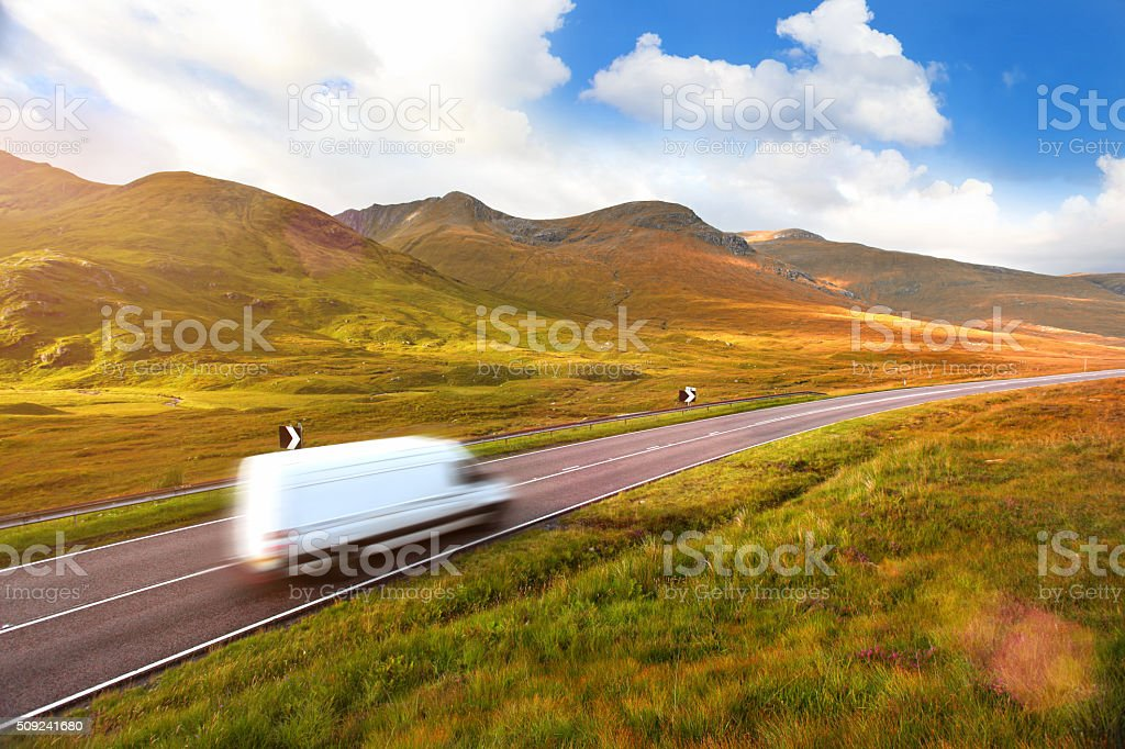 White delivery van speeding on a country road stock photo