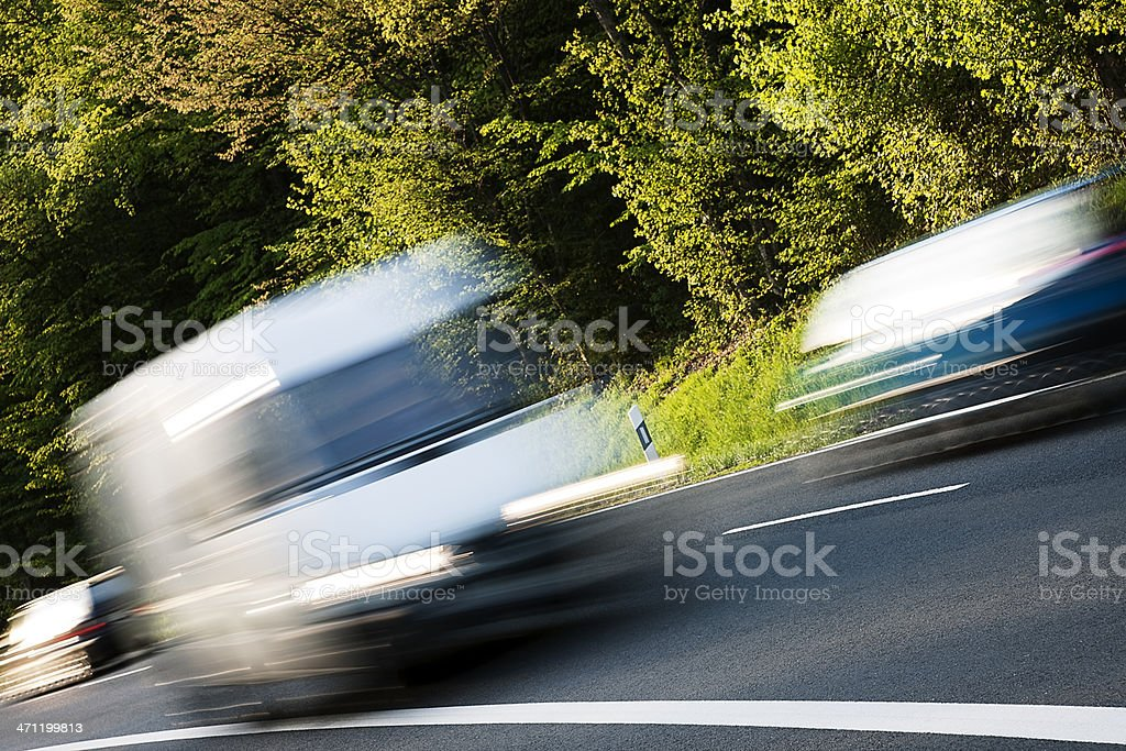 White Delivery Van Speeding on Country Road royalty-free stock photo