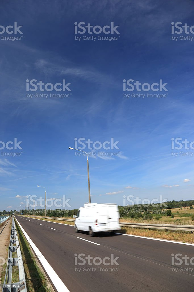 White Delivery Van Speeding on Highway royalty-free stock photo