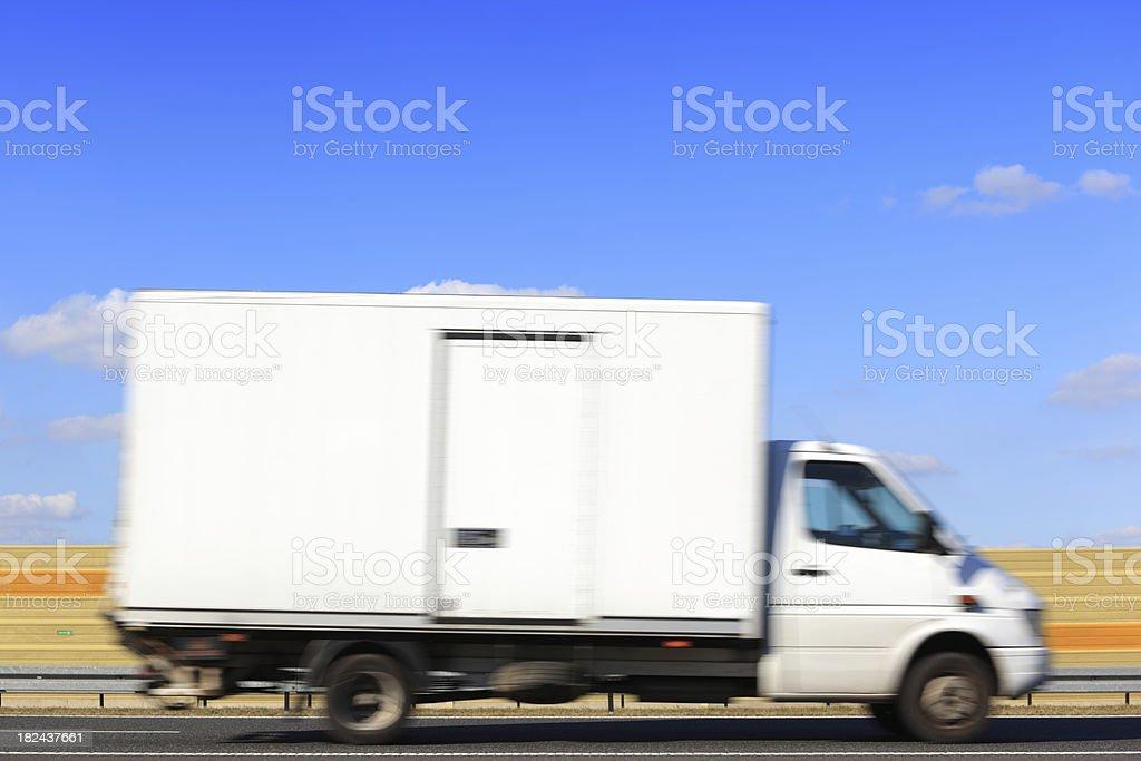 White Delivery Van Speeding on Highway royalty-free stock photo