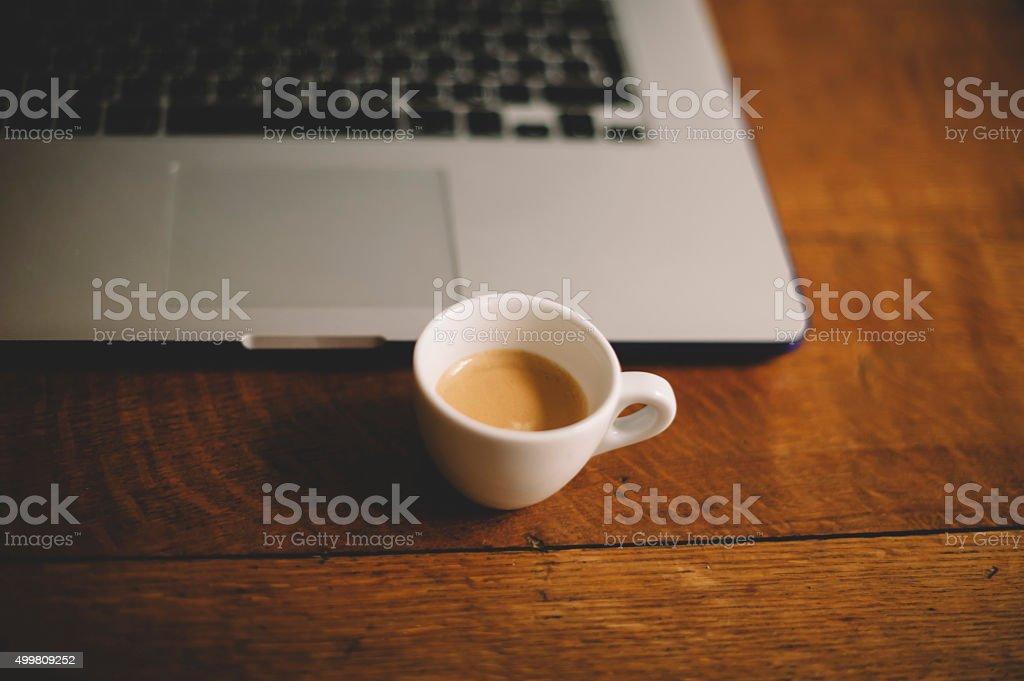 white demitasse cup of fresh morning espresso stock photo