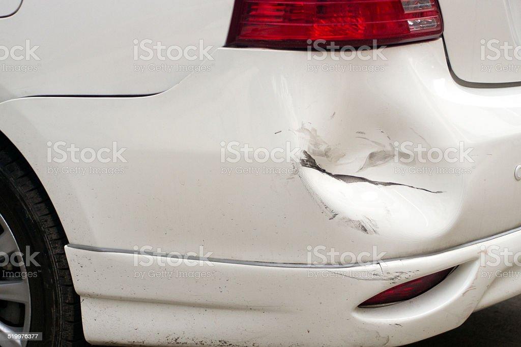 White dented car, broken car stock photo