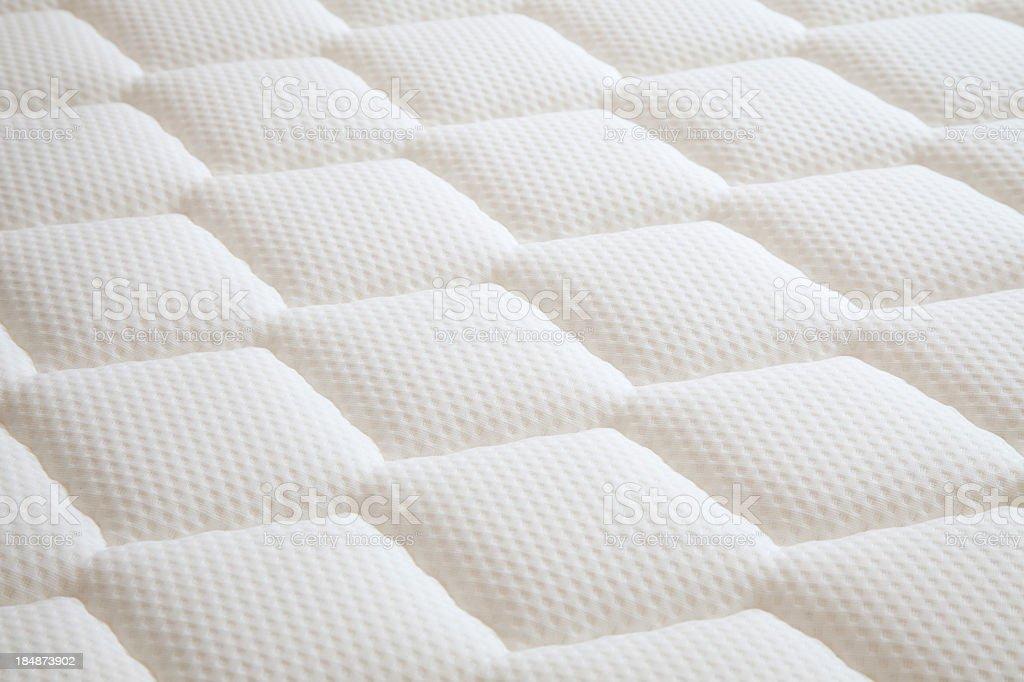 White diamond shaped mattress background stock photo