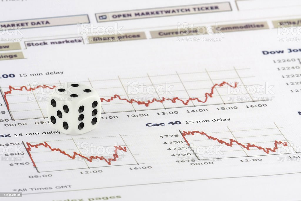 White dice over stock market graphs royalty-free stock photo