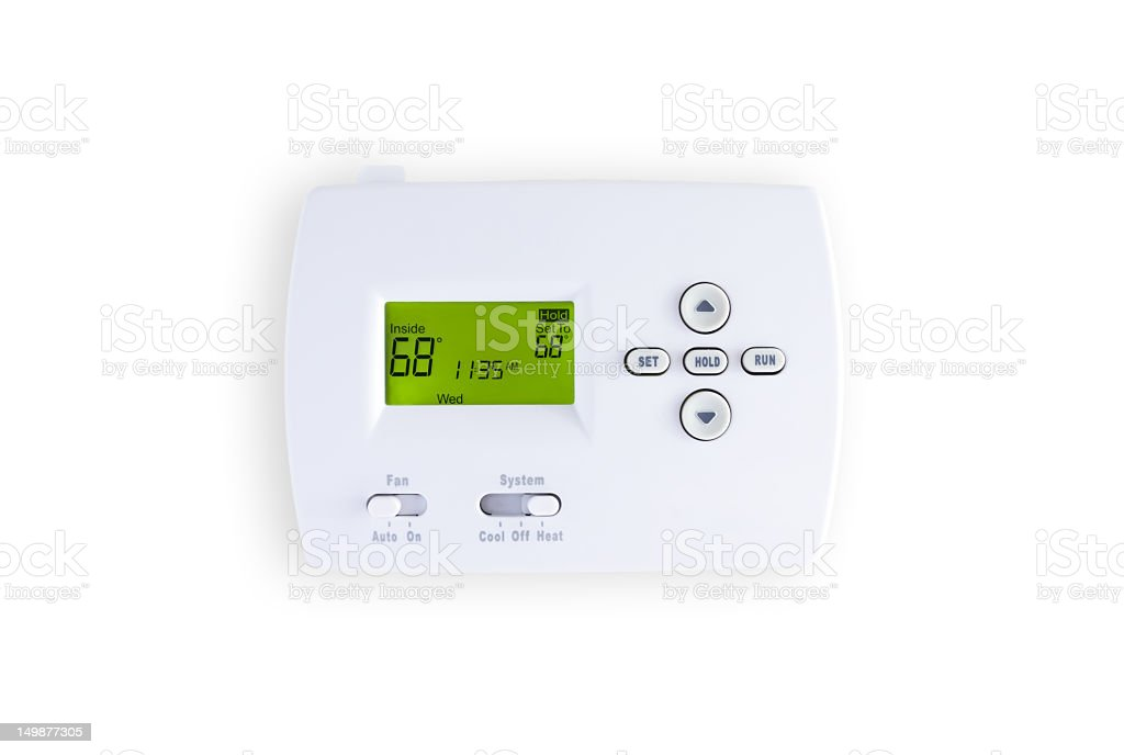 White Digital thermostat display on a white wall stock photo