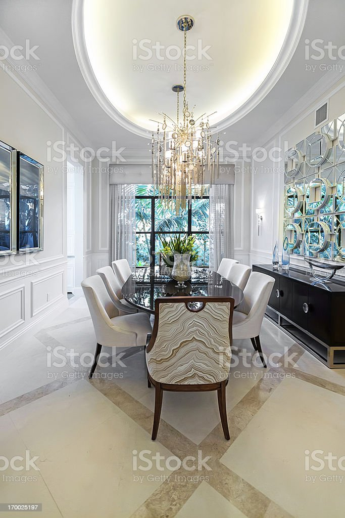 white dining room with chandelier stock photo