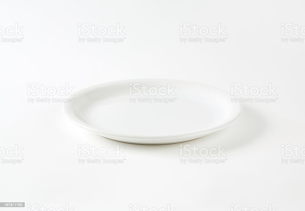 White dinner plate on a white background stock photo