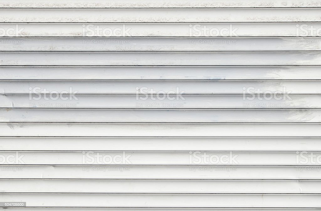 White dirty horizontal roller shutter blinds royalty-free stock photo