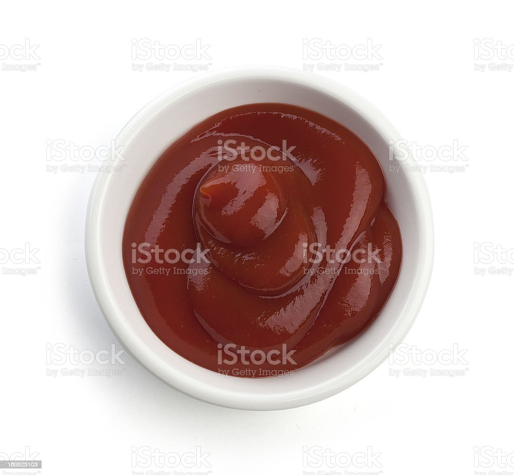 White dish filled with tomato sauce stock photo