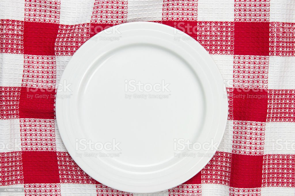 white dish on checkered table cloth stock photo