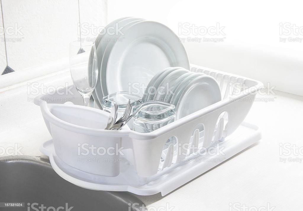 White Dishes Drying on Rack, High Key stock photo
