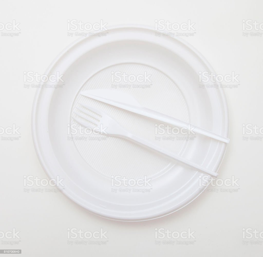 White disposable dishware set Fork and Knife stock photo