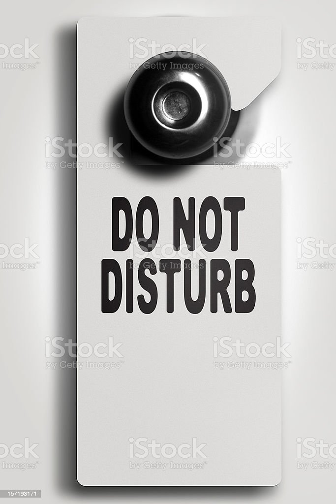 White do not disturb sign on door knob  stock photo