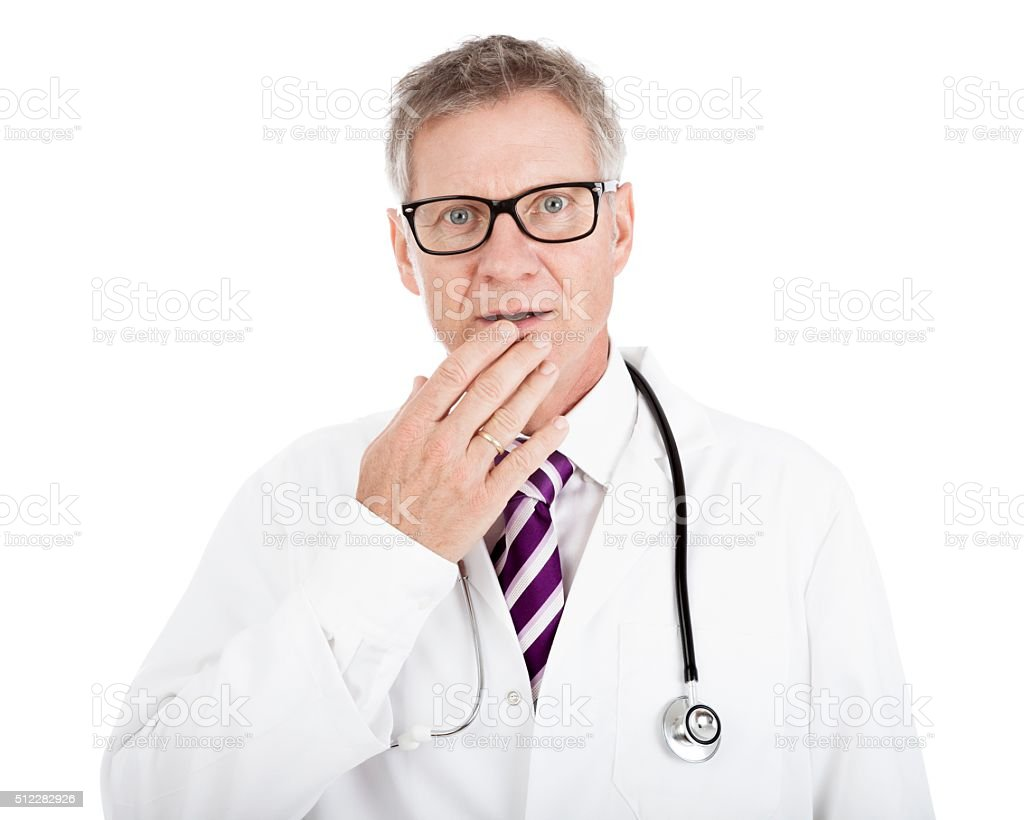 White Doctor Touching his Lip While in Doubt stock photo