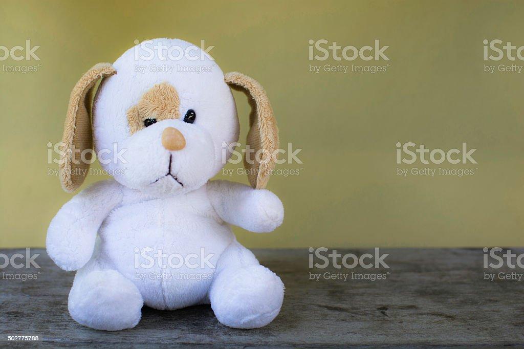 White dog doll/toy sitting royalty-free stock photo