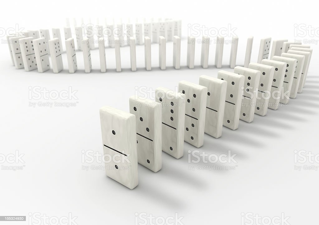 White dominos lined up on a white background stock photo