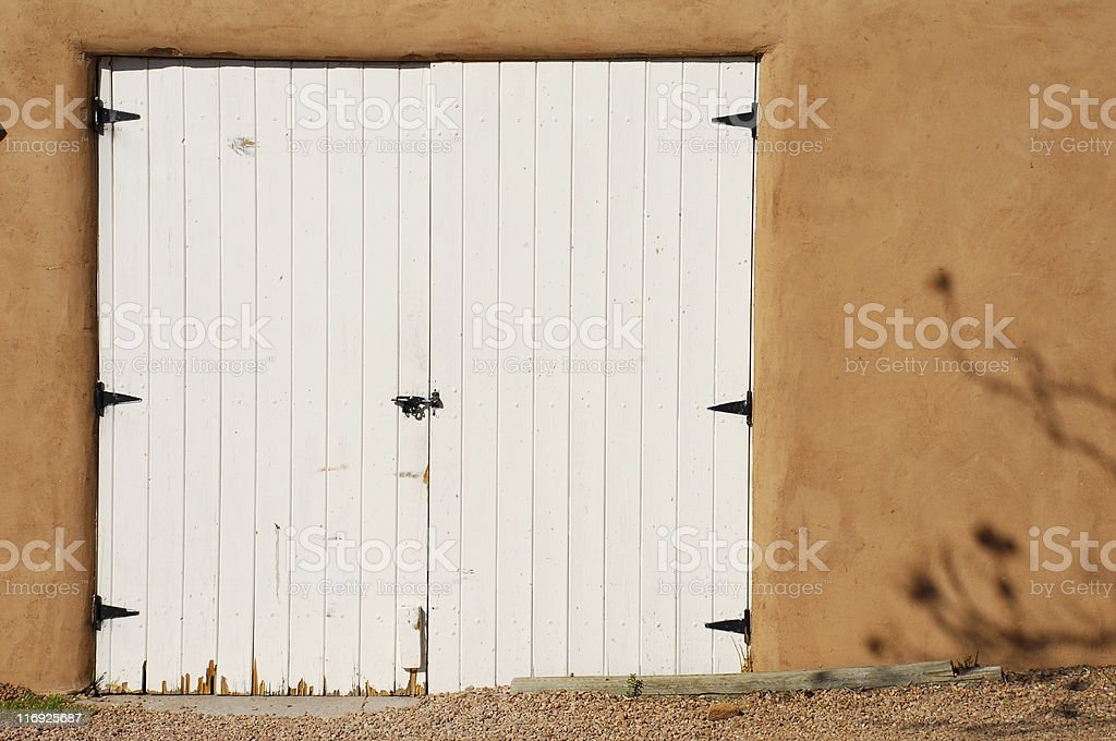 White Door and Adobe royalty-free stock photo