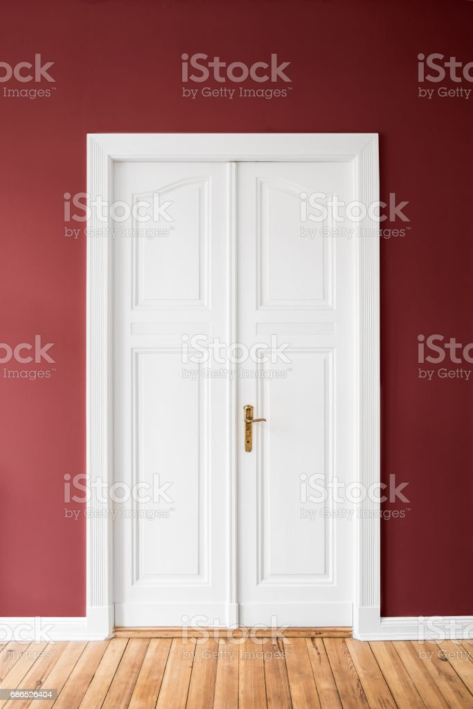 white door on red wall stock photo