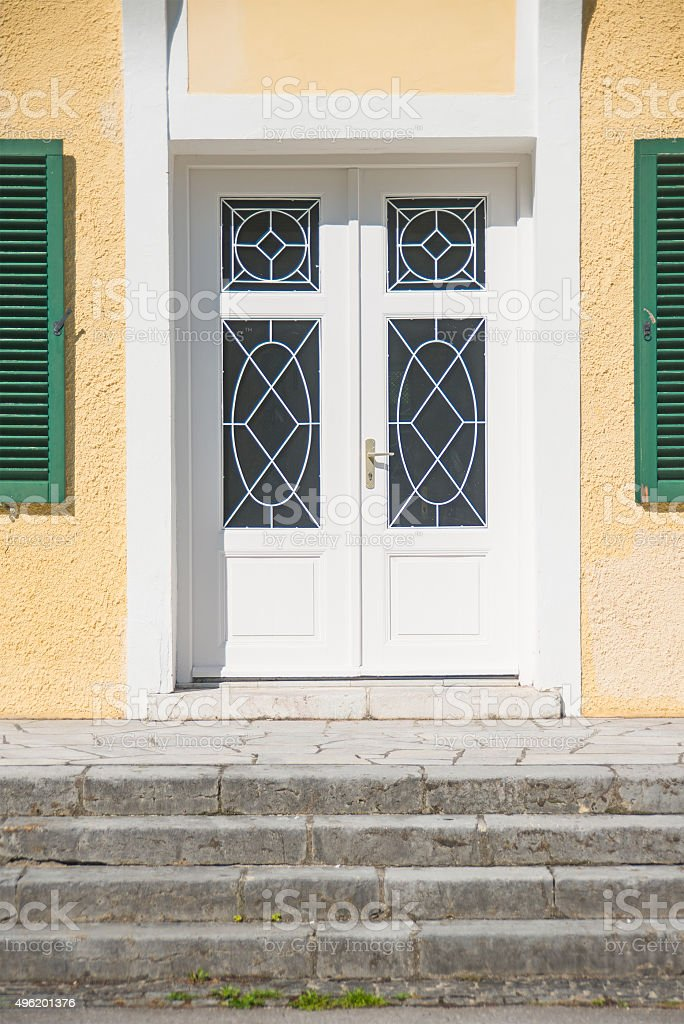 white door with stairs stock photo