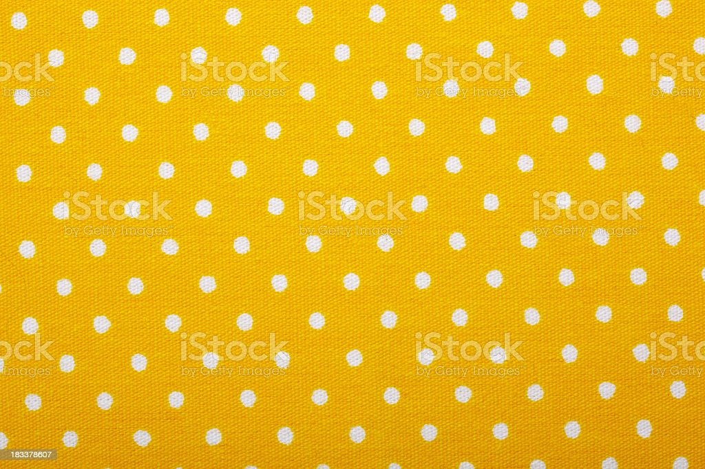 White dots on yellow stock photo
