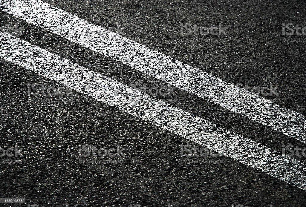 White double lines on gray asphalt royalty-free stock photo