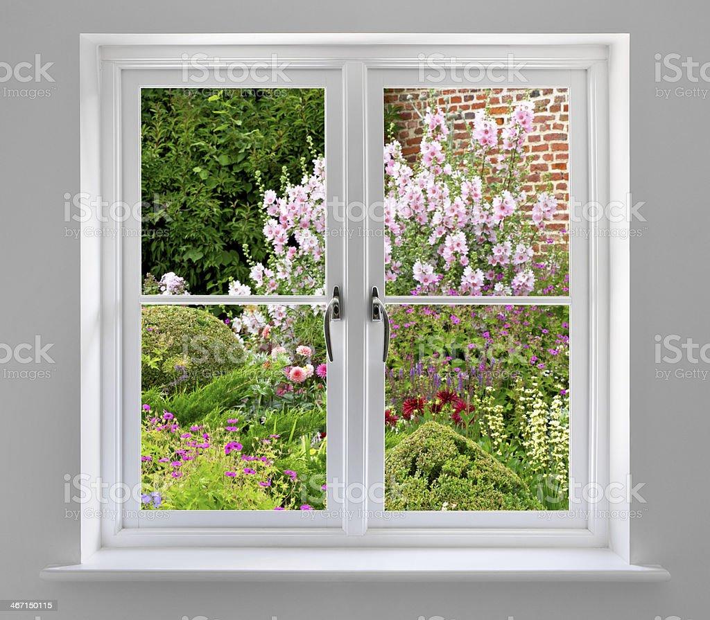 white double windows with garden views stock photo