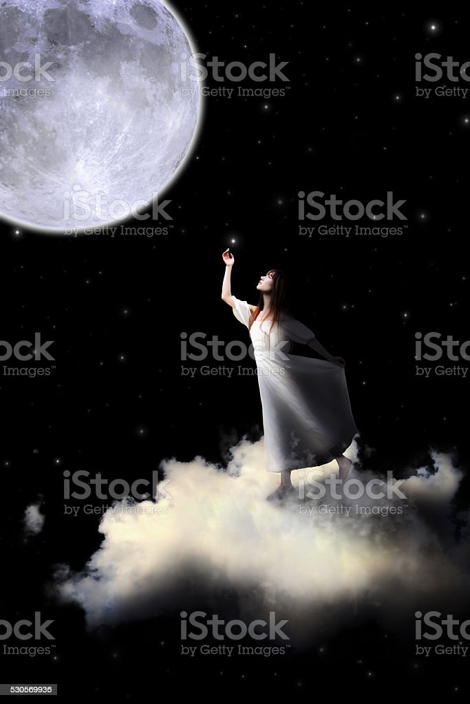 White dress girl riding on the clouds to the moon. stock photo