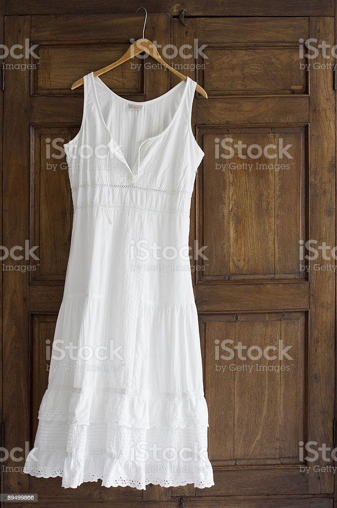 White Dress On Wardrobe stock photo