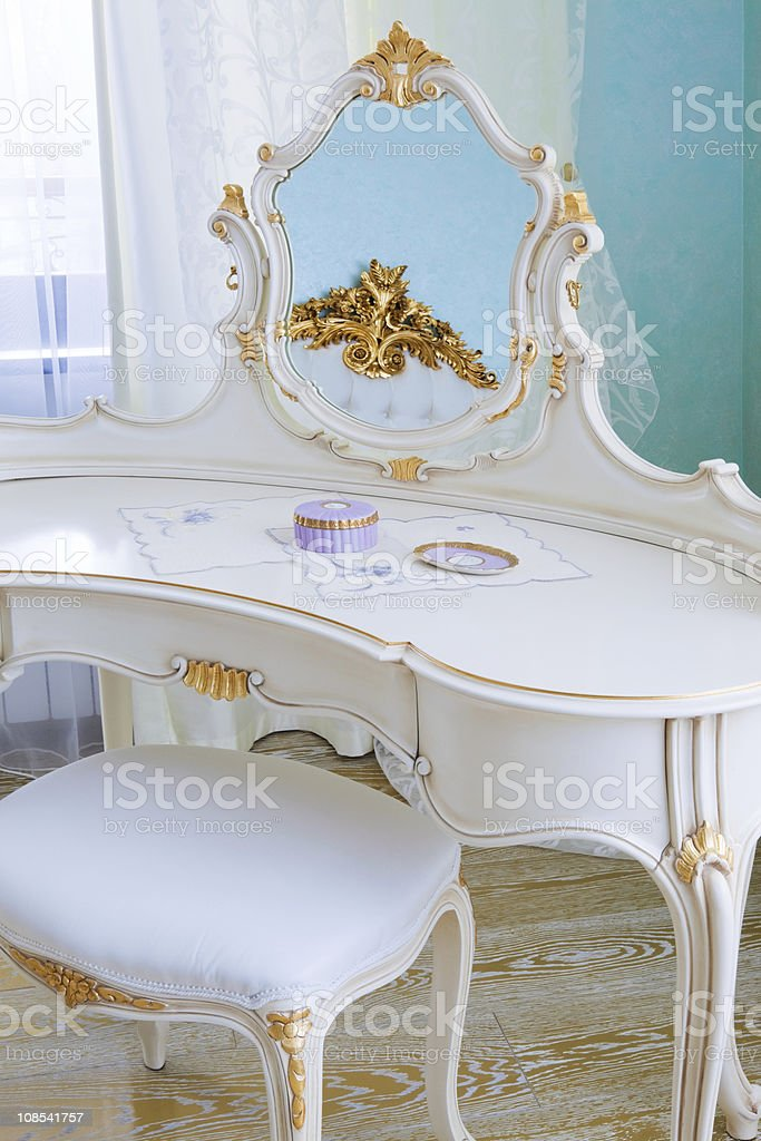 White dressing table with a mirror and stool stock photo