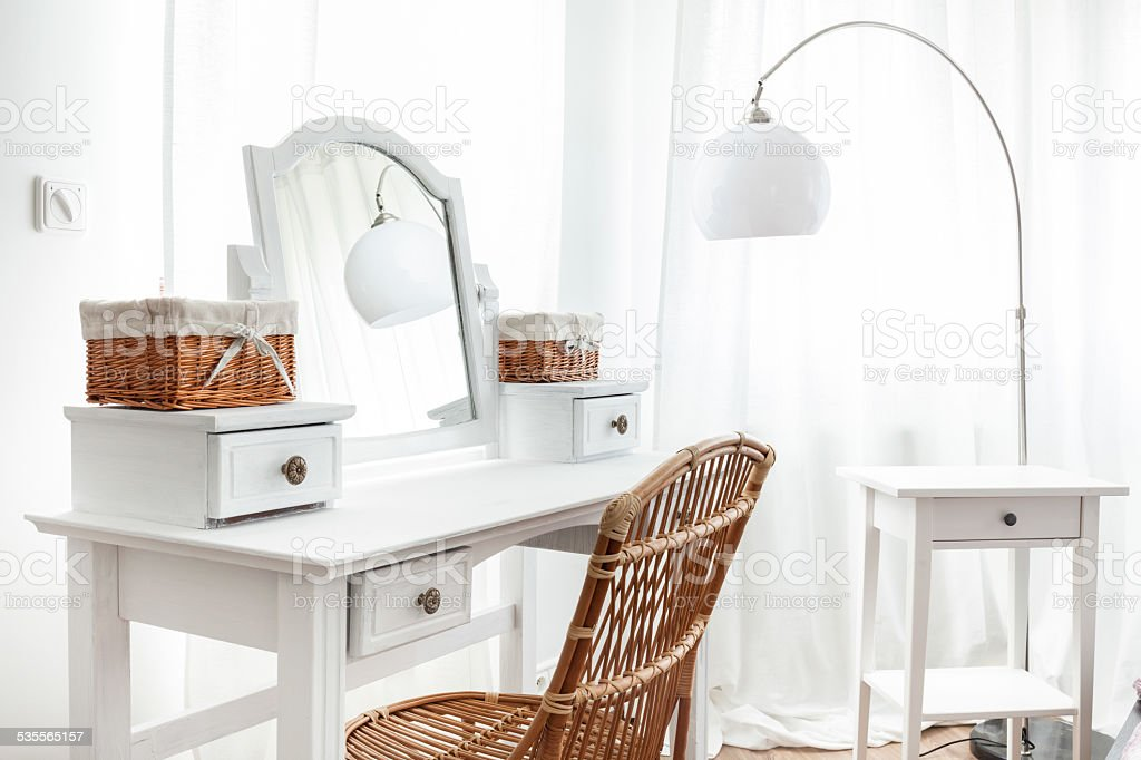 White dressing table with wicker elements stock photo