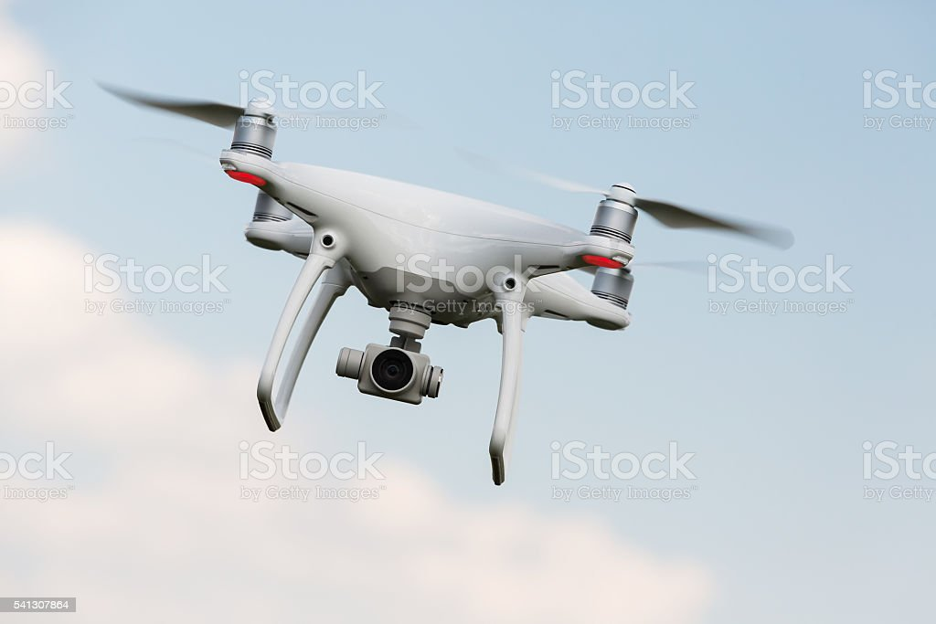 White drone with lights, quadrocopter with photo camera stock photo