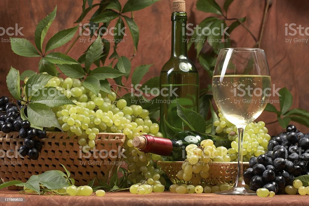 White dry wine, fresh clusters of a grapes royalty-free stock photo