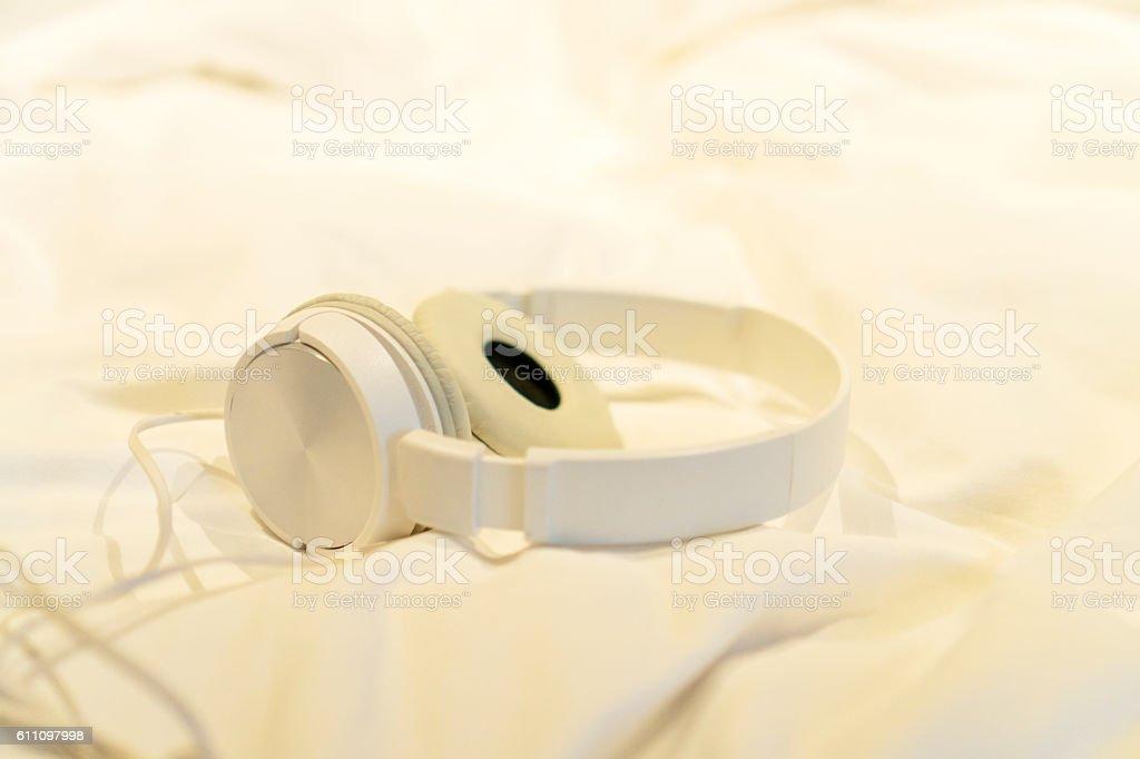 white earphone on bed stock photo