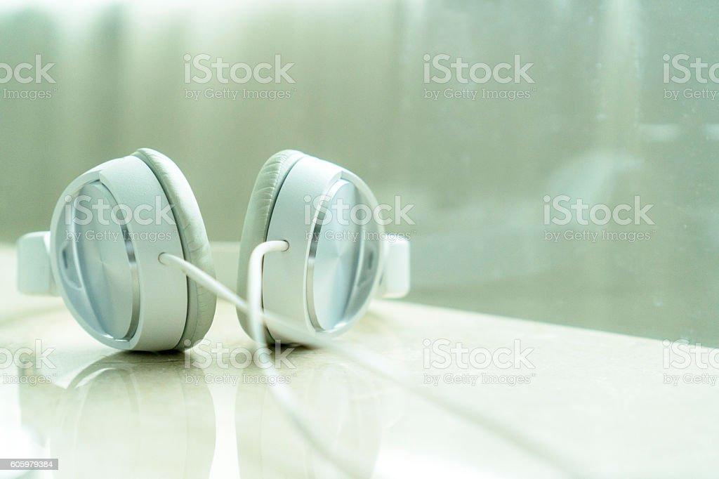white earphone on marble table stock photo