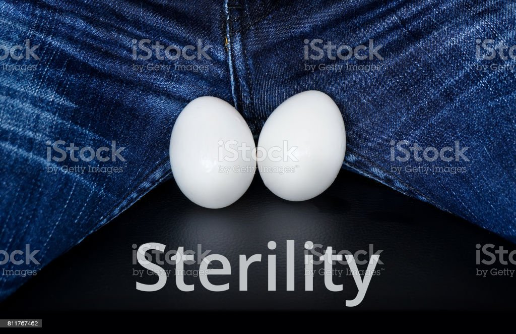White eggs - a symbol of man's balls with the inscription: Sterility stock photo