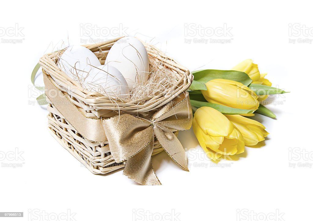 White eggs in a basket royalty-free stock photo