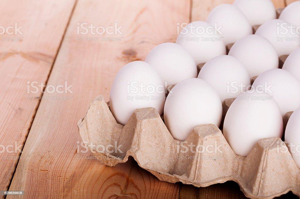White eggs on wood background stock photo