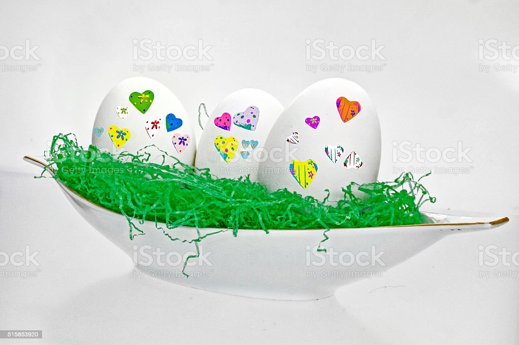 white eggs with colorful hearts stock photo