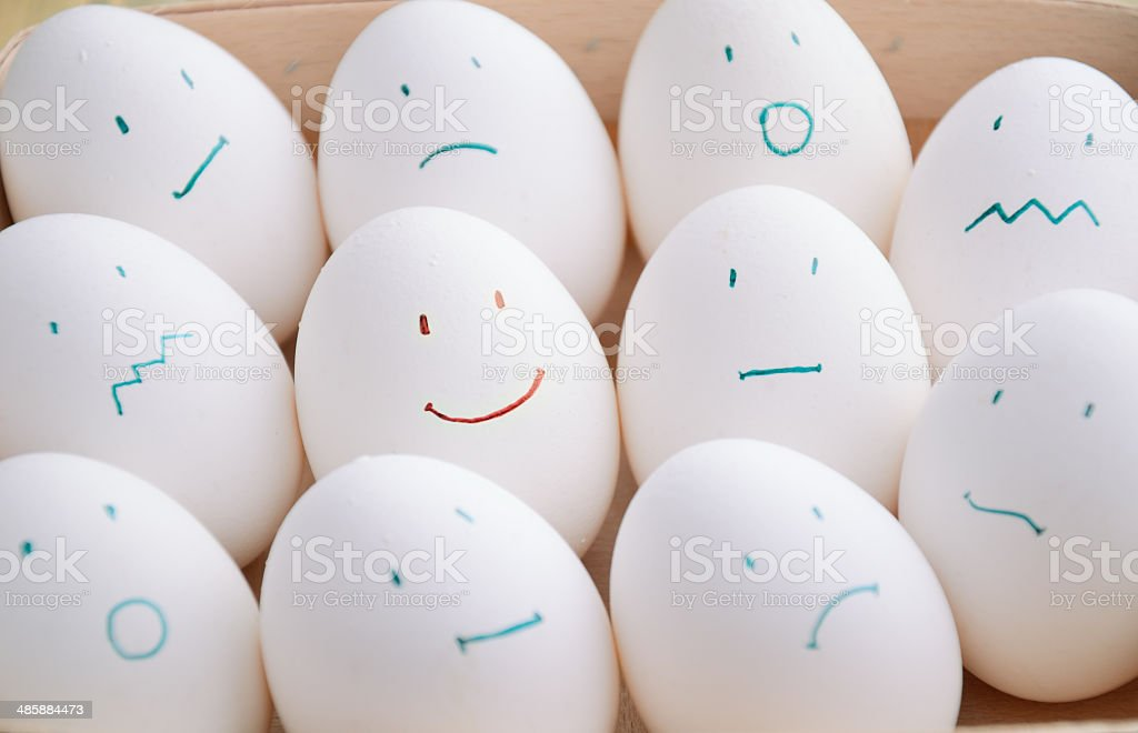white eggs with different emotions  in tray horizontal stock photo
