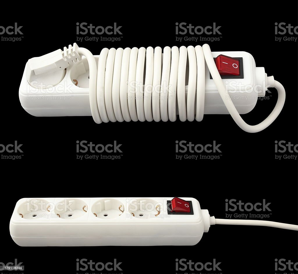 white electric splitter isolated over dark background royalty-free stock photo