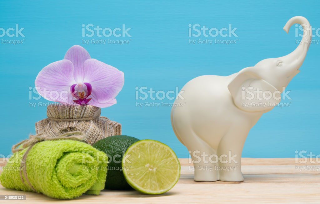 white elephant and spa items on the table stock photo